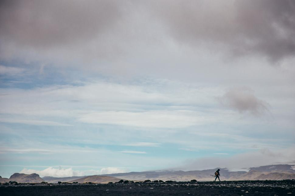 Download Free Stock HD Photo of A photographer hiking in Iceland volcanic landscape Online