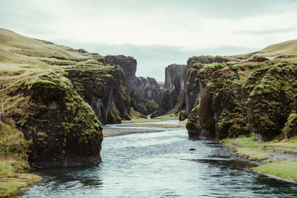 Download Free Stock HD Photo of A fresh water stream through the rocky hills Online