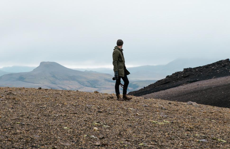 Download Free Stock HD Photo of A hiker in rocky Iceland field Online