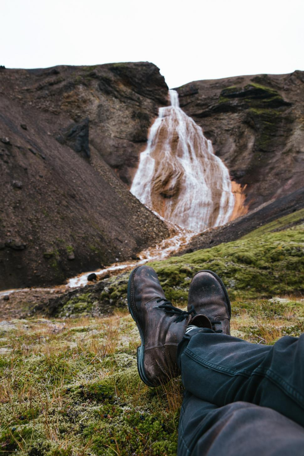 Download Free Stock HD Photo of Feet relaxing on moss grown rock Online
