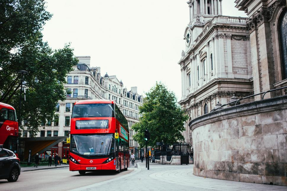Download Free Stock HD Photo of Red double decker bus on London road Online
