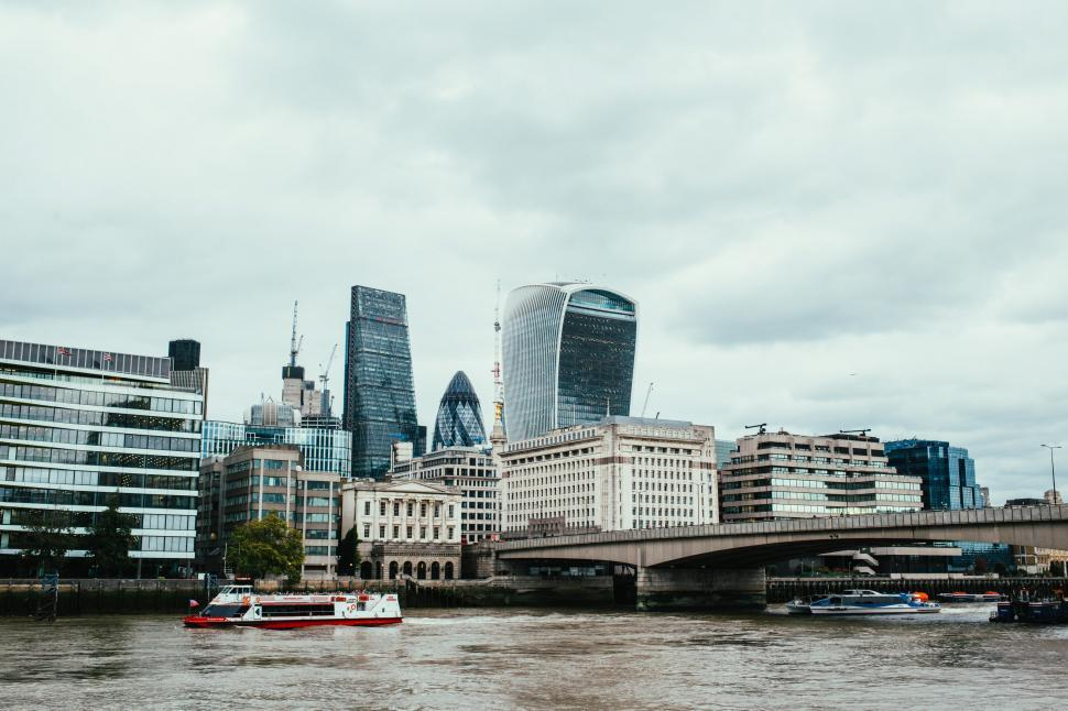 Download Free Stock HD Photo of Thames river with London skyscrapers in the background Online