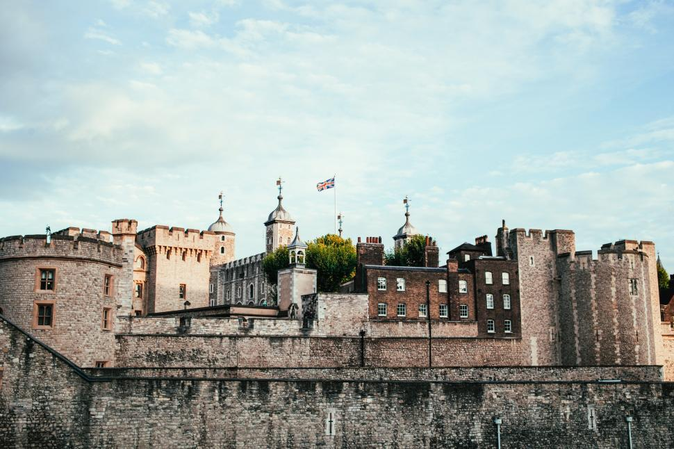 Download Free Stock HD Photo of Union jack fluttering above a castle Online