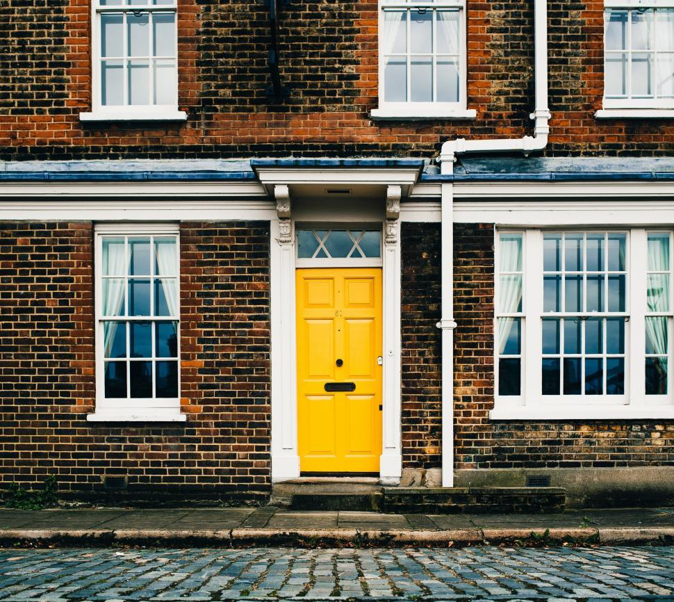 Download Free Stock HD Photo of Yellow entrance door on a brick home Online