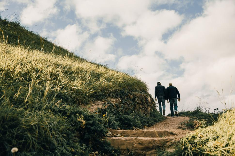 Download Free Stock HD Photo of Men hiking on grassy hills Online