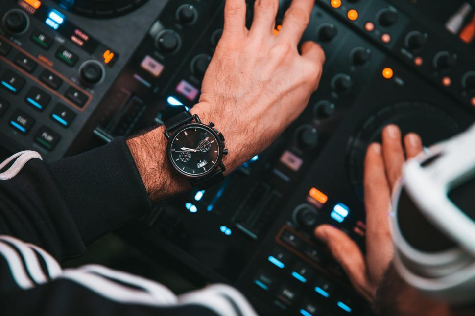 Download Free Stock HD Photo of DJ s hands on mixing console buttons Online