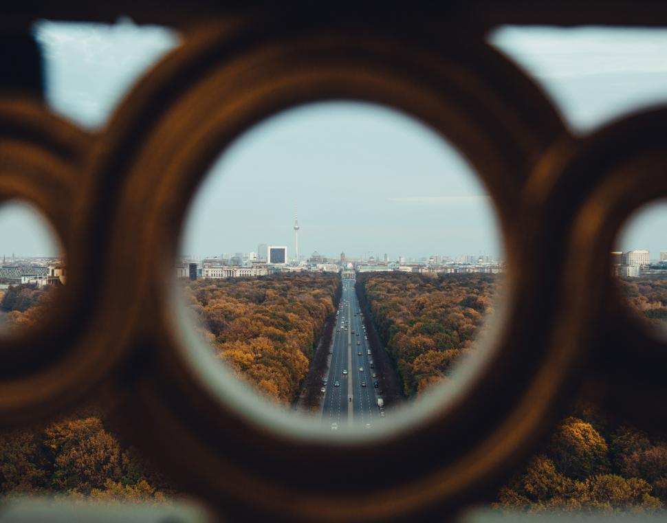 Download Free Stock HD Photo of A view of fall forest highway through high architecture Online