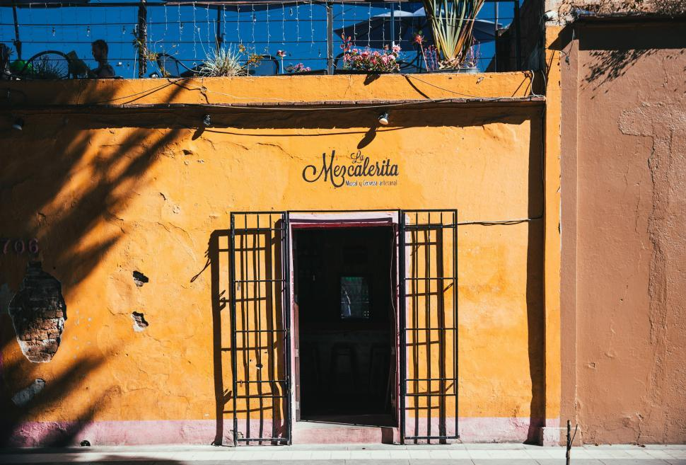 Download Free Stock HD Photo of Entrance of a tropical bar with yellow exterior Online