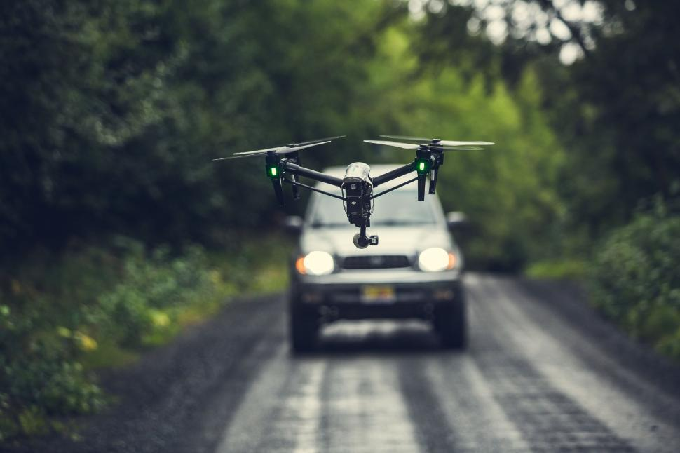 Download Free Stock HD Photo of A drone flying flying over the road Online