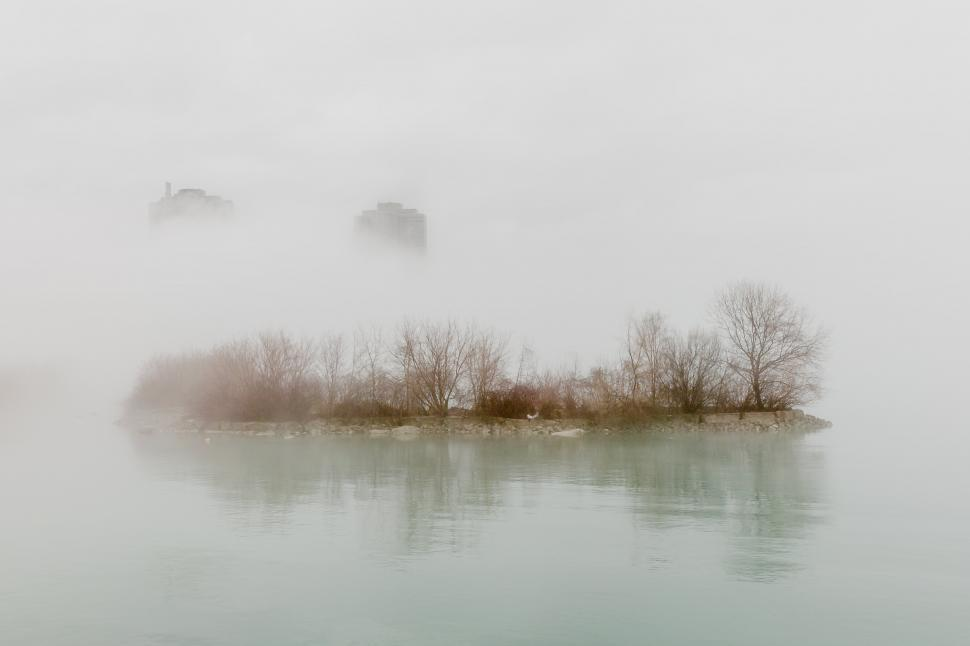Download Free Stock HD Photo of A fog covered city waterside Online
