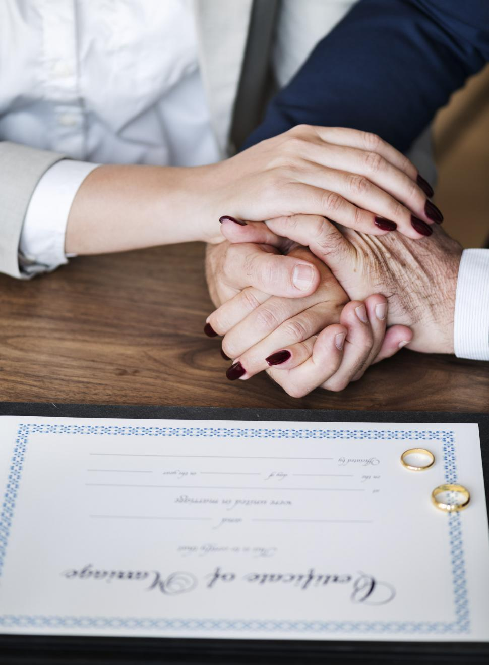 Download Free Stock HD Photo of Close up of a newly wed couple s hands stacked together Online
