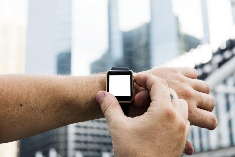 Download Free Stock HD Photo of Close up of a smart watch on the wrist Online