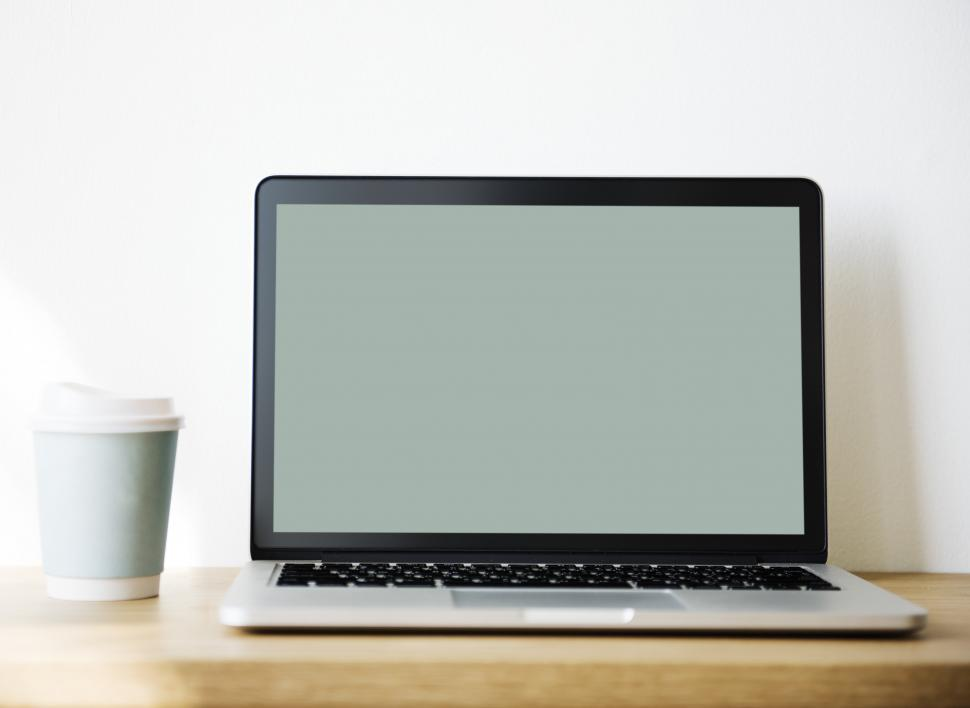 Download Free Stock HD Photo of Close up of a laptop on the table Online