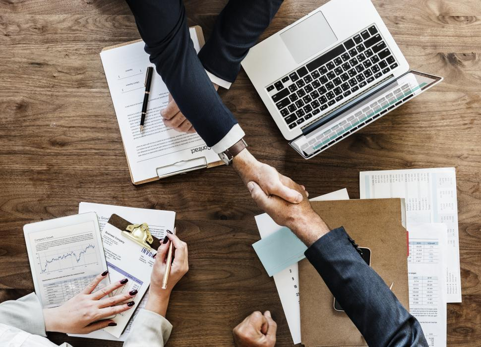 Download Free Stock HD Photo of Handshake between two businessmen on signing a contract Online