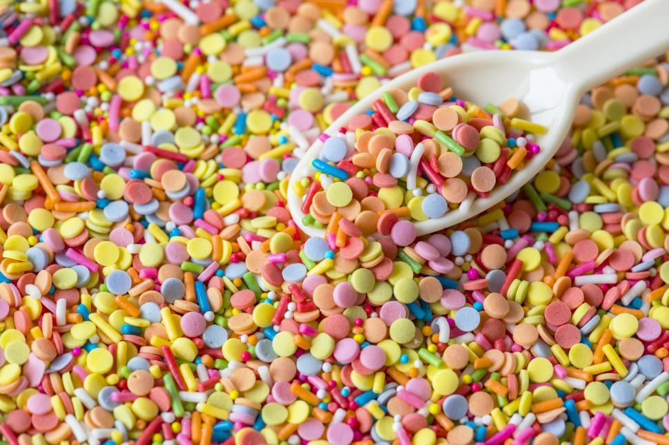 Download Free Stock HD Photo of Close of a spoonful of colorful candy balls and sprinkles Online