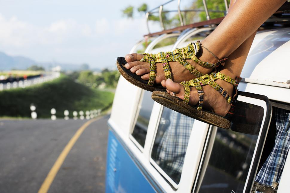 Download Free Stock HD Photo of Close up of a woman s feet hanging on the rooftop on a van Online
