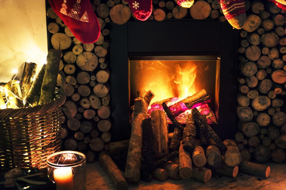 Download Free Stock HD Photo of Close up of a fireplace during Christmas Online