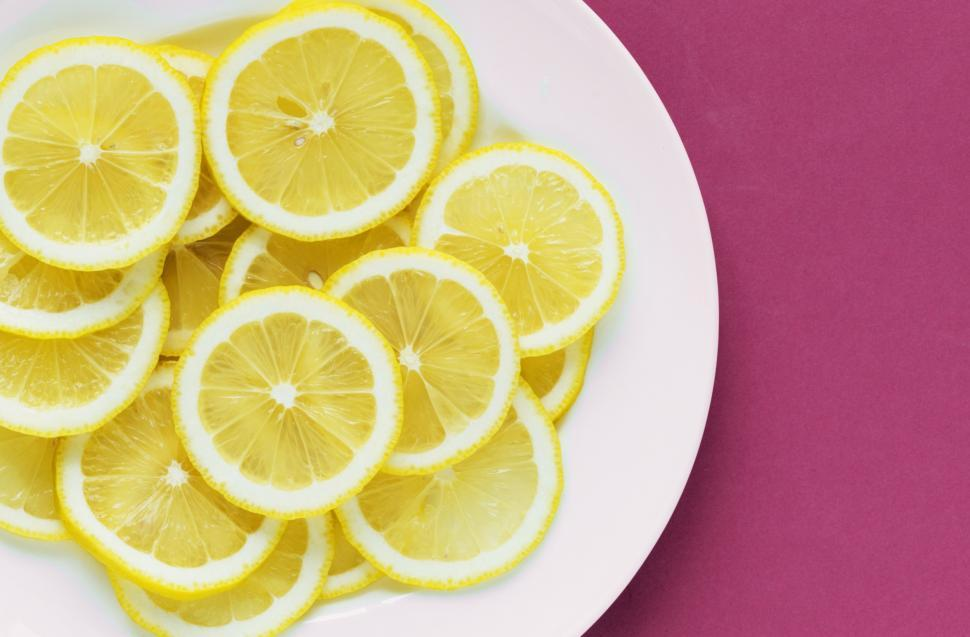 Download Free Stock HD Photo of Flat lay of lemon slices on white plate Online
