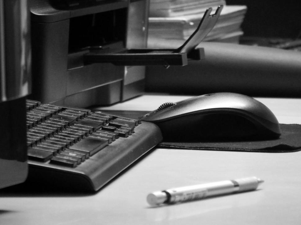 Download Free Stock HD Photo of Office equipment including keyboards, computers and printers  Online