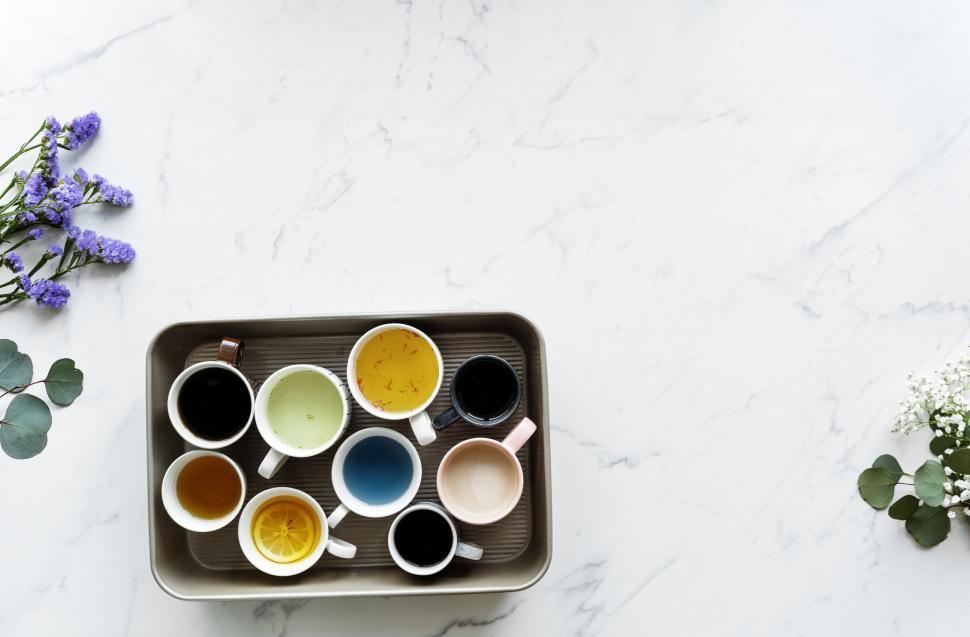 Download Free Stock HD Photo of Flay lay of a tray full of beverages in various cups and mugs Online