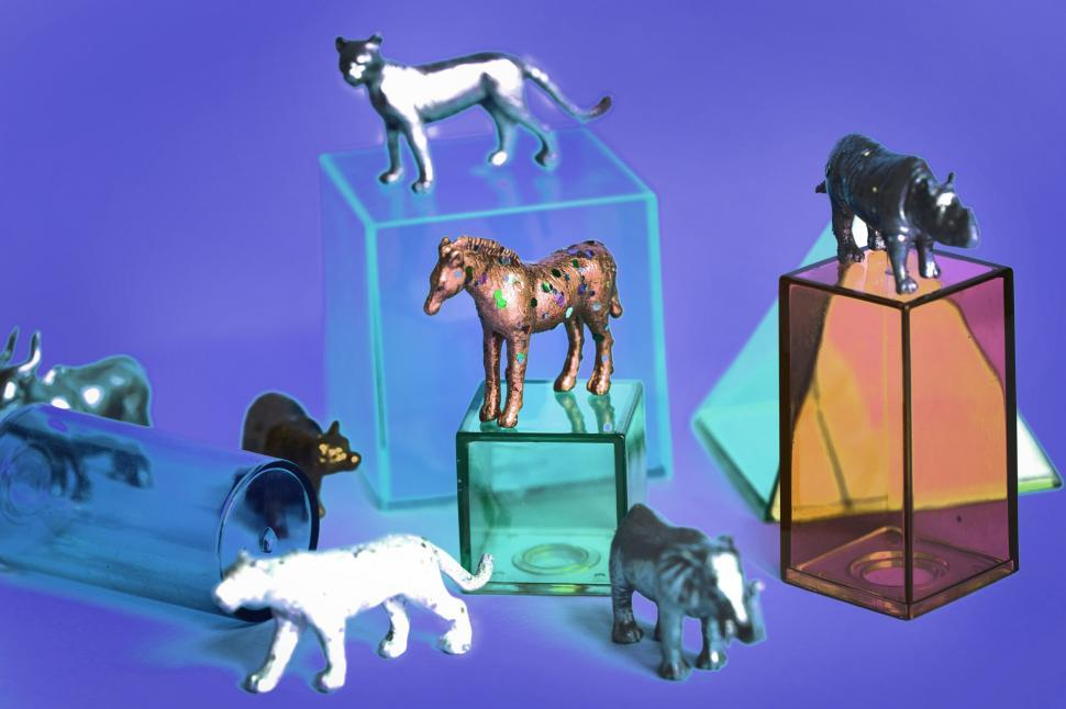 Download Free Stock HD Photo of Colorful toy animals with geometric glass figures Online