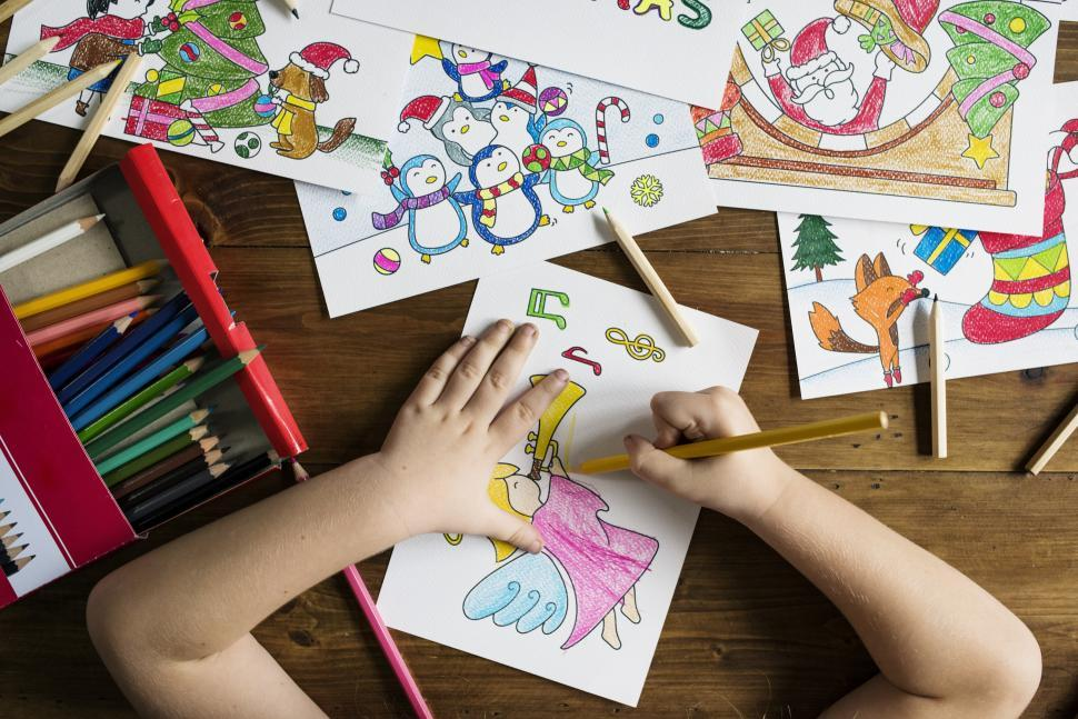 Download Free Stock HD Photo of A childs hands coloring a picture Online