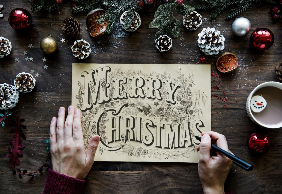 Download Free Stock HD Photo of Close up of Merry Christmas calligraphy surrounded with Christma Online