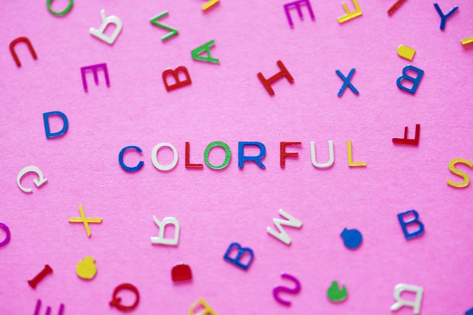 Download Free Stock HD Photo of Flat lay of the word COLORFUL arranged with plastic alphabet blo Online