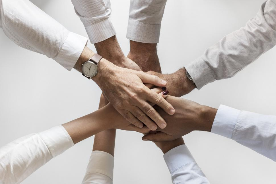 Download Free Stock HD Photo of Flat lay of hands stacked together in a huddle Online
