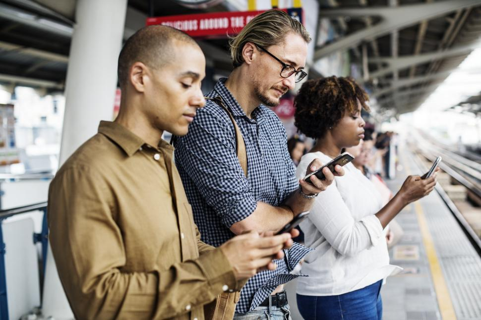 Download Free Stock HD Photo of Multiethnicity Commuters looking at their mobile phones Abstract Colorful Pattern - Squares and Rectangles Online