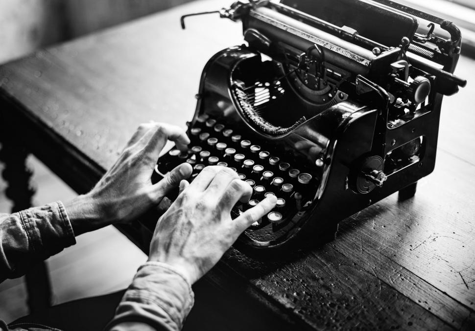Download Free Stock HD Photo of Black and white photo of hands typing on an antique typewriter Abstract Colorful Pattern - Squares and Rectangles Online