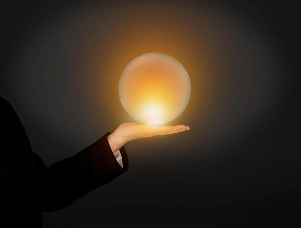 Download Free Stock HD Photo of Hand Holding Glowing Crystal Ball - Predicting the Future Concept - Divination  Online