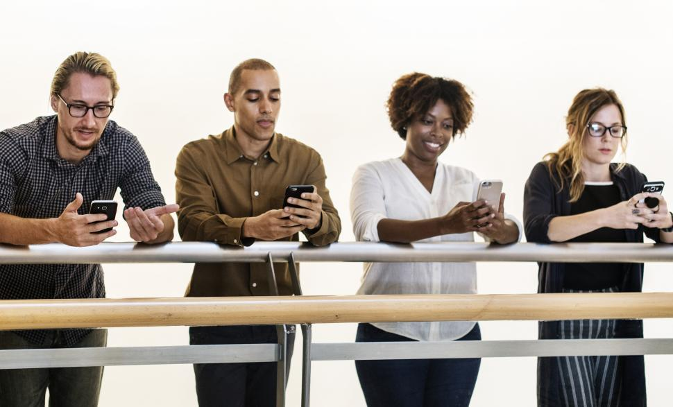 Download Free Stock HD Photo of Multiethnicity colleagues looking at their mobile phones Online