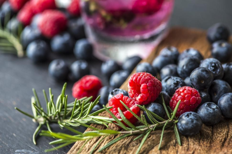 Download Free Stock HD Photo of Close up of raspberries and blueberries Online