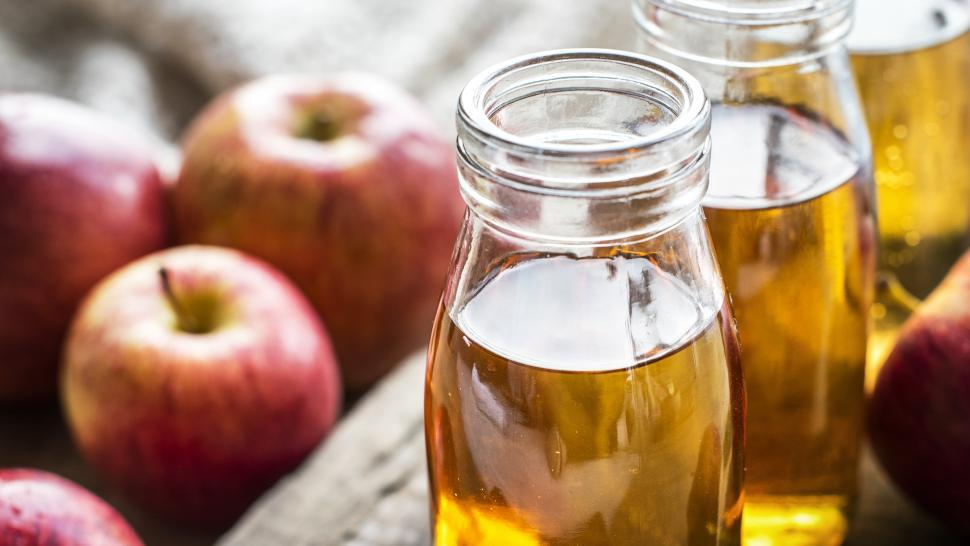 Download Free Stock HD Photo of Close up of apple juice bottles Online