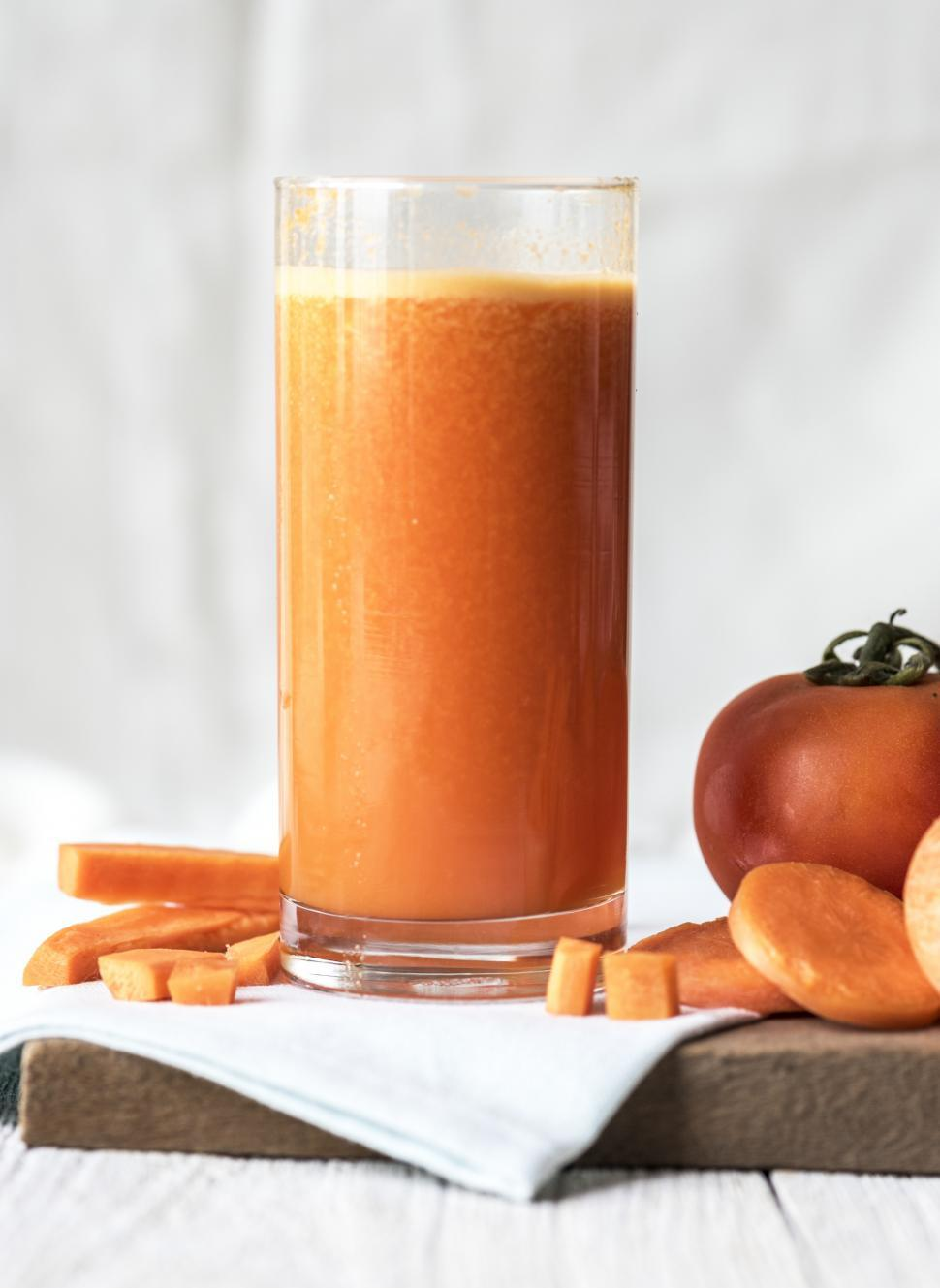 Download Free Stock HD Photo of Close up of carrot juice served in a glass Online