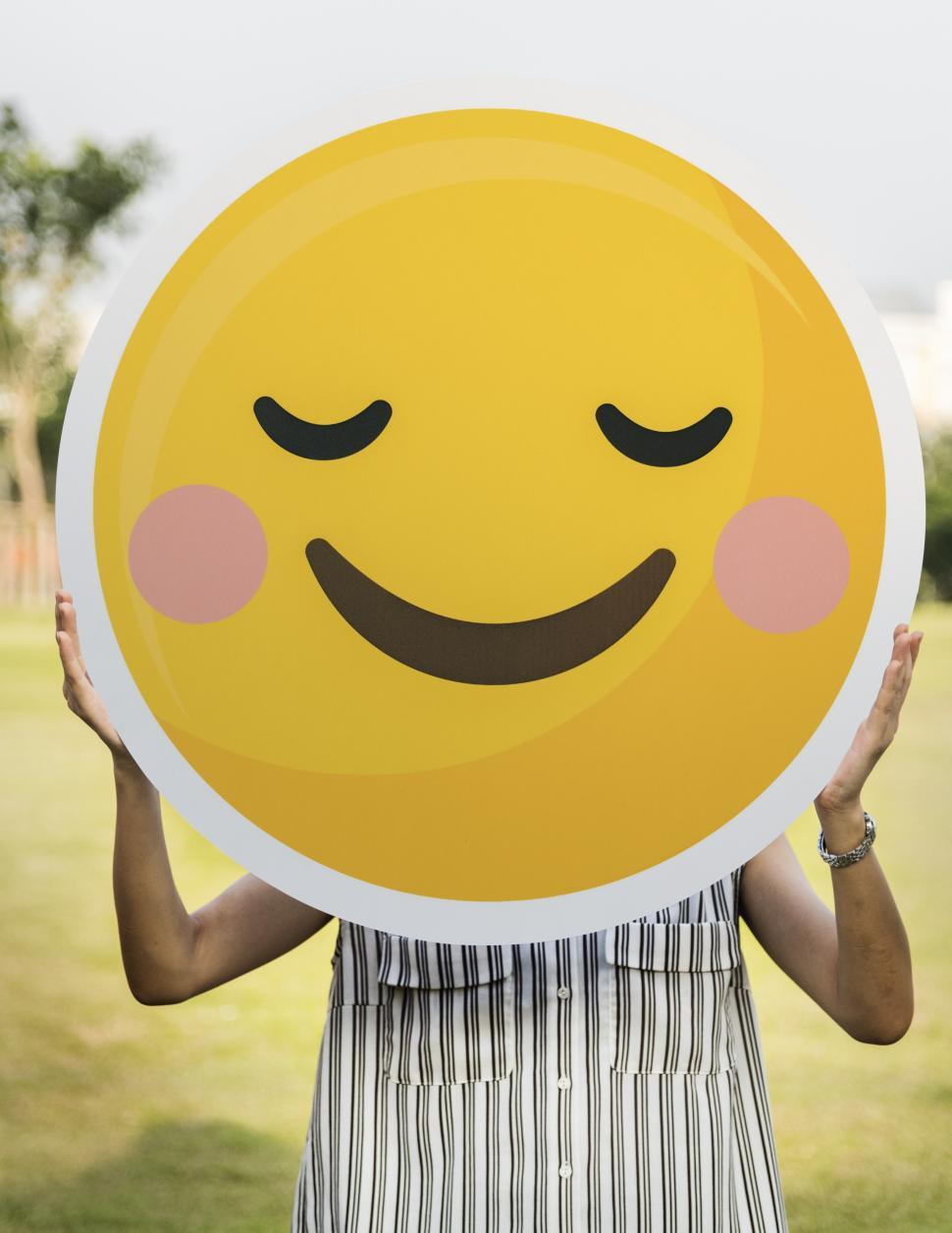 Download Free Stock HD Photo of Close up of a smiley cut out in a person s hand Online