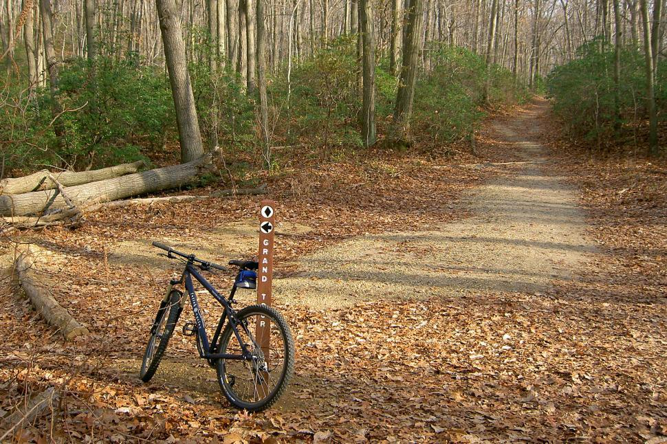Download Free Stock HD Photo of Mountain Bikes By A Trail Marker Online