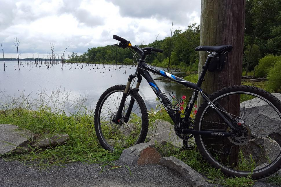 Download Free Stock HD Photo of Mountain Bike By A Lake Online