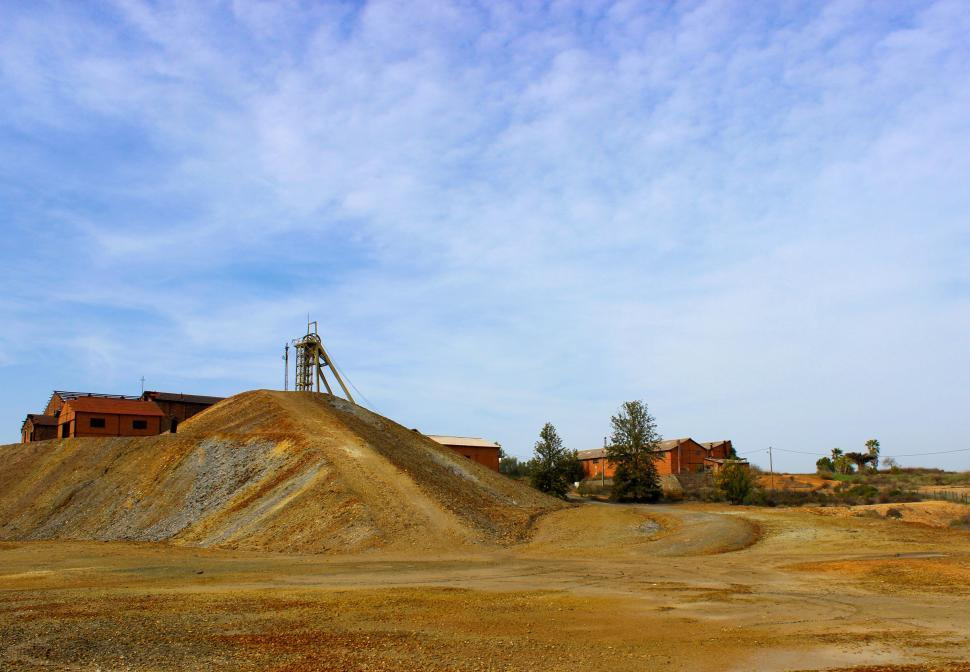 Download Free Stock HD Photo of Exterior of An Old Mine - Shaft and Tailings Online