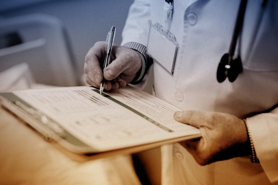 Download Free Stock HD Photo of Doctor Writing Prescription Online