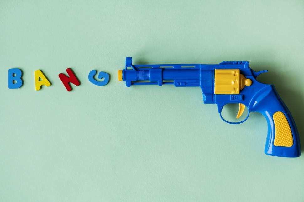 Download Free Stock HD Photo of Flat lay of the text BANG depicted as being fired from a toy gun Online