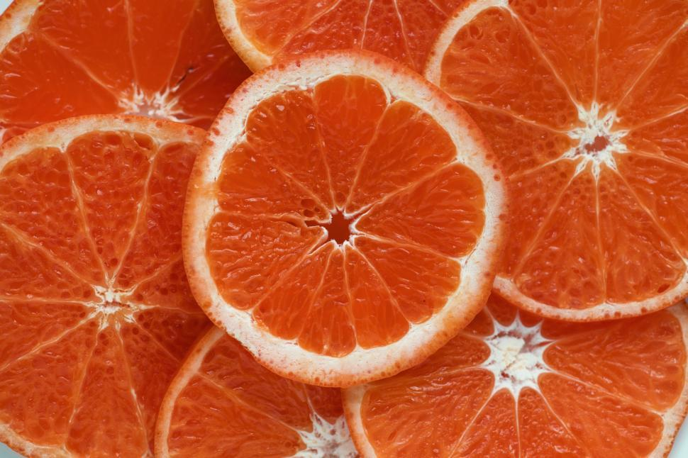 Download Free Stock HD Photo of Flat lay of tangerine slices Online