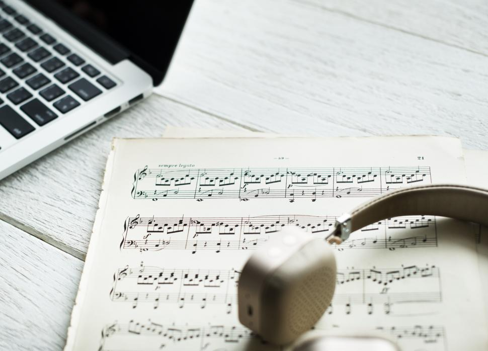 Download Free Stock HD Photo of Close up of music notes and a headphone Online