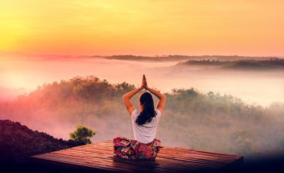 Download Free Stock HD Photo of Woman Practicing Yoga at Sunrise Over Rainforest - Dawn Online