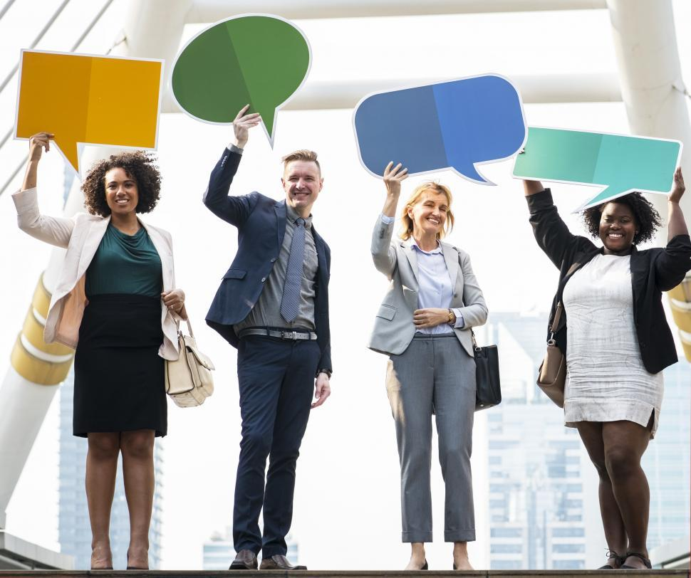 Download Free Stock HD Photo of A group of multiethnicity colleagues raising cardboard speech bubbles Online