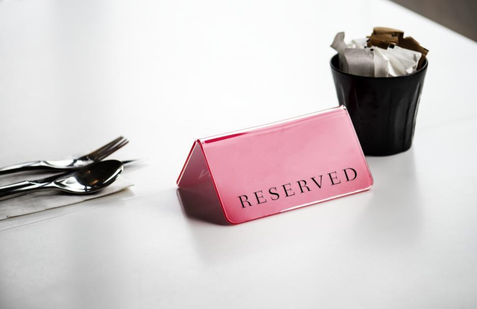 Download Free Stock HD Photo of Close up of a  Reserved  sign on the table Online