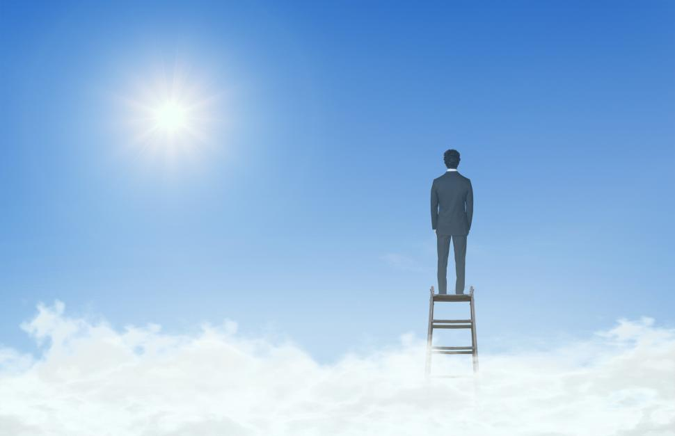 Download Free Stock HD Photo of Businessman On Top of Ladder Above the Clouds Online
