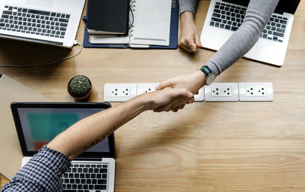 Download Free Stock HD Photo of Handshake between the laptops Online