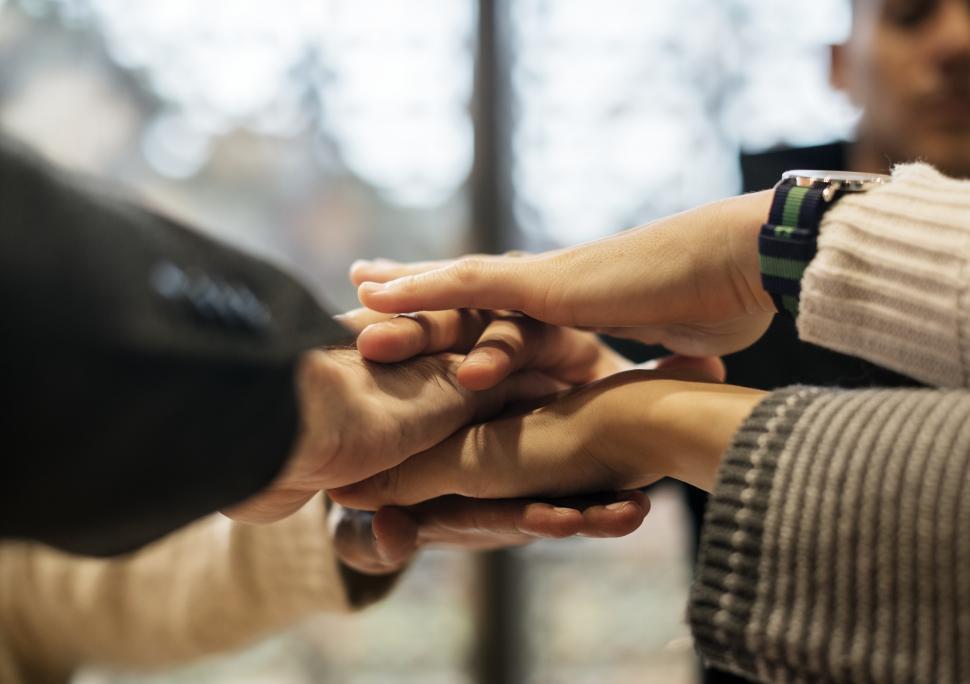 Download Free Stock HD Photo of Hands stacked together in solidarity after a meeting Online